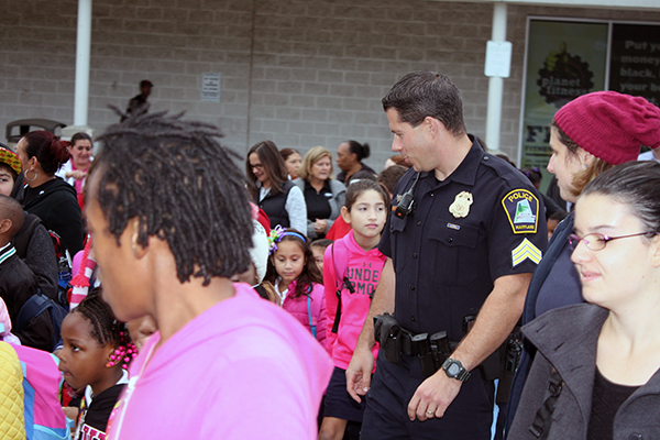 Officer talking to kids