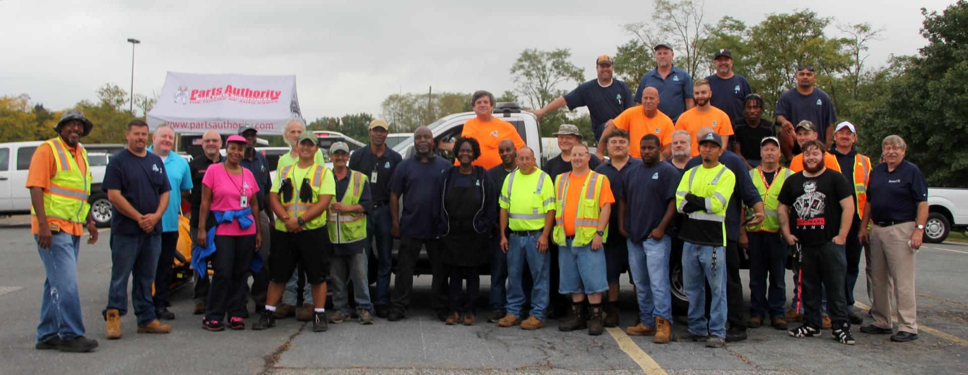 Large group w/ many people in high-visibility outerwear