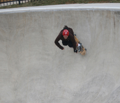 Different person skating down a deep basin
