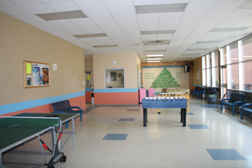 Tiled room with ping-pong and foosball tables