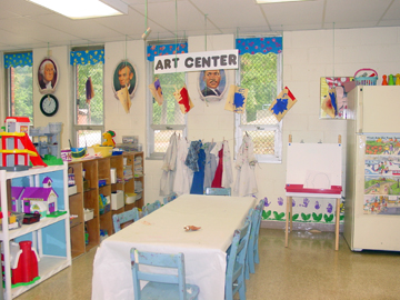 "Mom's Morning Out classroom, featuring table and ""Art Center"" sign"