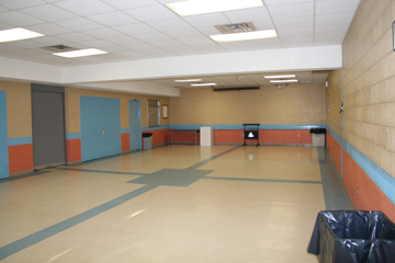 Multipurpose Room, a large empty tiled room