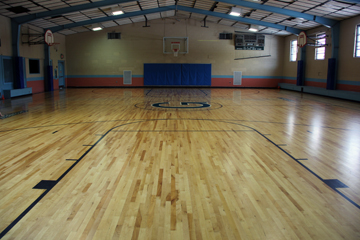 Gym with basketball court markings on floor
