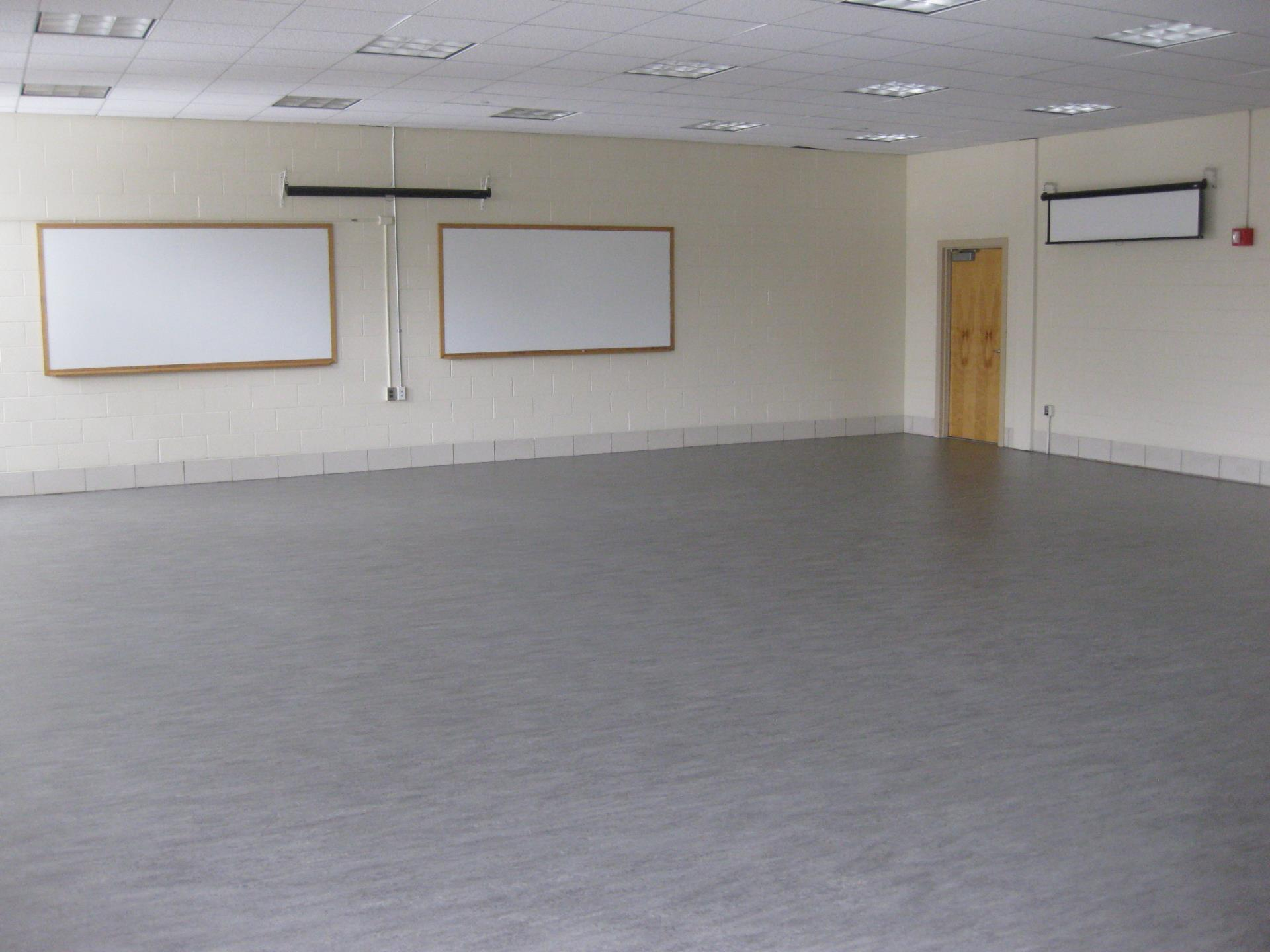 Large empty room with two whiteboards